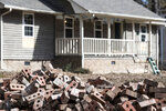 A pile of bricks sits in front of a home scheduled to be raised after being damaged by flooding from Hurricane Florence near the Crabtree Swamp, Friday, Feb. 1, 2019, in Conway, S.C. According to the homeowner the other residences in his immediate neighborhood have been purchased by F.E.M.A. and scheduled for demolition. (AP Photo/Sean Rayford)