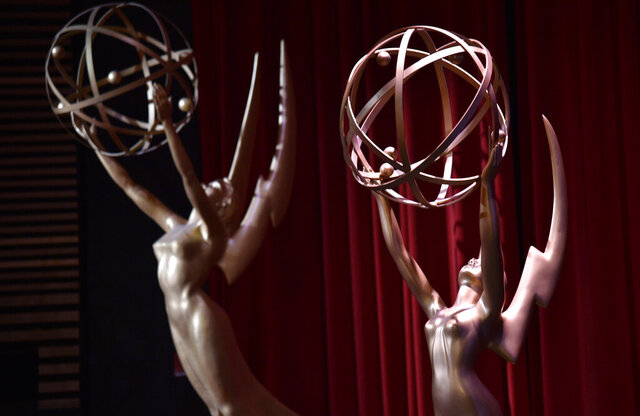 FILE - In this July 12, 2018, file photo, Emmy statues appear on stage at the 70th Primetime Emmy Nominations Announcements at the Television Academy's Saban Media Center, in Los Angeles. The Emmy Awards, the first big Hollywood ceremony to attempt a live -- but socially distanced -- broadcast amid the pandemic, will be held on Sunday, Sept. 20, 2020, and producers are promising a live TV experience with 100 cameras in the homes of nominees, and all the chaos that could entail. (Photo by Chris Pizzello/Invision/AP, File)