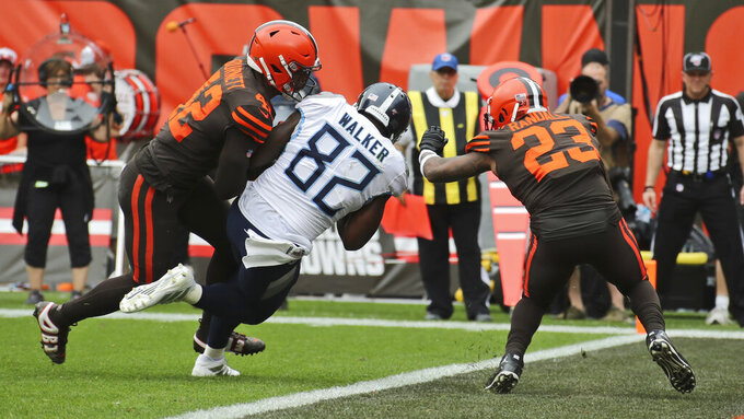 Tennessee Titans tight end Delanie Walker (82) scores a touchdown during the second half in an NFL football game against the Cleveland Browns, Sunday, Sept. 8, 2019, in Cleveland. (AP Photo/Ron Schwane)