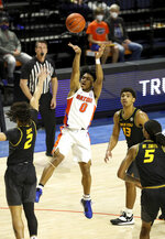 Florida guard Ques Glover (0) puts up a shot during an NCAA college basketball game against Missouri, Wednesday, March 3, 2021 in Gainesville, Fla. (Brad McClenny/The Gainesville Sun via AP)