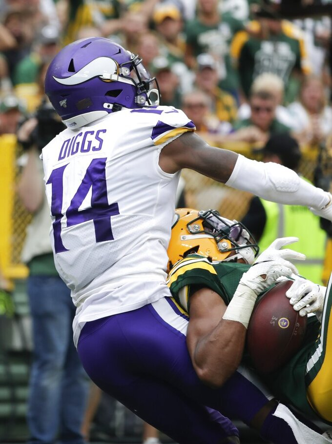 Green Bay Packers' Kevin King intercepts a pass intended for Minnesota Vikings' Stefon Diggs during the second half of an NFL football game Sunday, Sept. 15, 2019, in Green Bay, Wis. (AP Photo/Morry Gash)