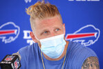 """FILE - Buffalo Bills receiver Cole Beasley addresses the media following practice at NFL football training camp in Orchard Park, N.Y., in this Wednesday, July 28, 2021, file photo. The NFL can't mandate the vaccine but it made its stance clear through strict protocols for players who don't get it. Cole Beasley has strongly argued against the vaccine, even engaging in public debate with teammates about it on Twitter. """"I'm not anti- or pro-vax. I'm pro choice,"""" Beasley said. (AP Photo/Jeffrey T. Barnes, File)"""