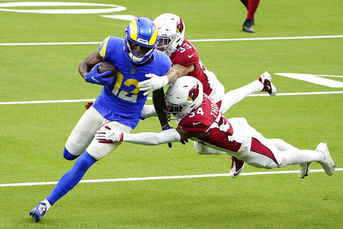 Los Angeles Rams wide receiver Van Jefferson (12) runs against Arizona Cardinals free safety Jalen Thompson (34) and cornerback Byron Murphy (33) during the second half of an NFL football game in Inglewood, Calif., Sunday, Jan. 3, 2021. (AP Photo/Jae C. Hong)