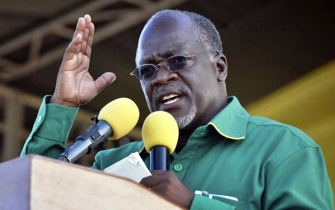 FILE - In this Friday, Oct. 23, 2015 file photo, President John Magufuli gestures during an election rally in Dar es Salaam, Tanzania. President John Magufuli of Tanzania, a prominent COVID-19 skeptic whose populist rule often cast his country in a harsh international spotlight, has died aged 61 of heart failure, it was announced Wednesday, March 17, 2021 by Vice President Samia Suluhu. (AP Photo/Khalfan Said, File)