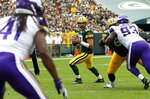 FILE - Green Bay Packers' Aaron Rodgers throws during the first half of an NFL football game against the Minnesota Vikings, Sunday, Sept. 15, 2019, in Green Bay, Wis. Aaron Rodgers will begin his 16th season with Green Bay looking  to continue his remarkable run of success against NFC North opponents as the Packers visit Minnesota. The Packers own a 47-18-1 record in games Rodgers has played against NFC North foes, including a  6-0 mark last season. (AP Photo/Mike Roemer, File)