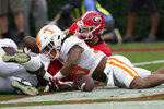 Tennessee linebacker Kivon Bennett (95) recovers a fumble in the end zone for a touchdown in the first half of an NCAA college football game against Georgia, Saturday, Oct. 10, 2020, in Athens, Ga. (AP Photo/John Bazemore)