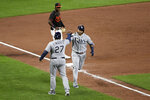 Tampa Bay Rays' Nelson Cruz celebrates with third base coach Rodney Linares (27) after hitting a three-run home run against the Baltimore Orioles during the sixth inning of a baseball game Friday, Aug. 6, 2021, in Baltimore. (AP Photo/Will Newton)