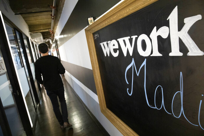 This Tuesday, Nov. 5, 2019, photo shows a WeWork office space in New York. WeWork said Friday, Nov. 8 it will divest from several side businesses and cut jobs as part of a 90-day plan to turn itself around following its botched attempt to sell stock on Wall Street. (AP Photo/Mark Lennihan)
