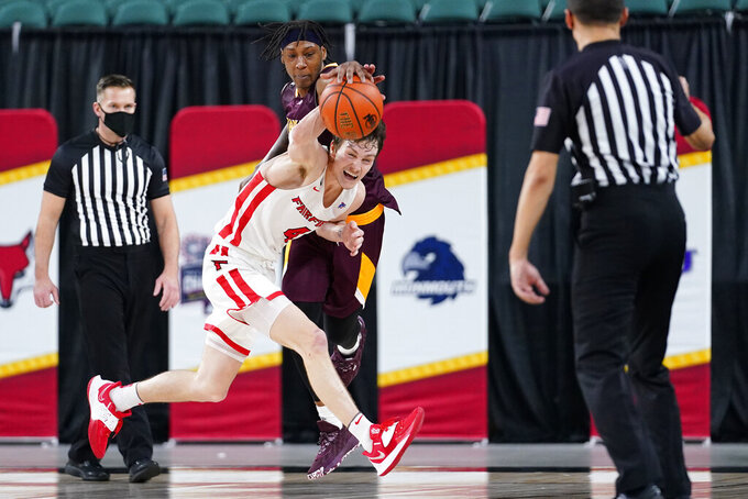 Fairfield's Jake Wojcik, bottom, and Iona's Isaiah Ross battle for the ball in the second half of an NCAA college basketball game during the finals of the Metro Atlantic Athletic Conference tournament, Saturday, March 13, 2021, in Atlantic City, N.J. (AP Photo/Matt Slocum)