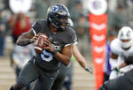 FILE - In this Thursday, Nov. 22, 2018, file photo, Air Force quarterback Donald Hammond III rolls out of the pocket against Colorado State in the second half of an NCAA college football game at Air Force Academy, Colo. The Falcons return seven players on defense and seven more on offense. They certainly have experience at quarterback after Donald Hammond III and Isaiah Sanders split time last season.  (AP Photo/David Zalubowski, File)