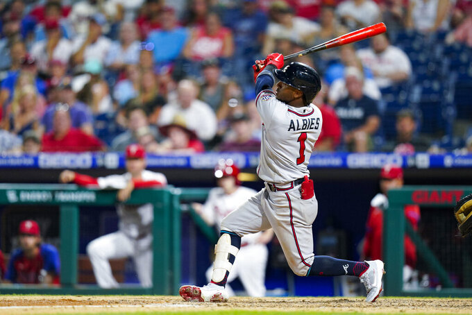 Atlanta Braves' Ozzie Albies watches his three-run home run during the eighth inning of the team's baseball game against the Philadelphia Phillies, Saturday, July 24, 2021, in Philadelphia. (AP Photo/Chris Szagola)