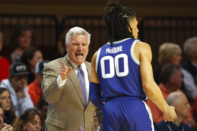 Kansas State coach Bruce Weber shouts to guard Mike McGuirl (0) during the second half of the team's NCAA college basketball game against Oklahoma State in Stillwater, Okla., Wednesday, March 4, 2020. (AP Photo/Brody Schmidt)