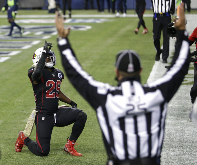 Arizona Cardinals running back Chase Edmonds, left, reacts after he caught a pass against the Seattle Seahawks for a touchdown during the second half of an NFL football game, Thursday, Nov. 19, 2020, in Seattle. (AP Photo/Lindsey Wasson)
