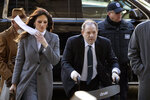 Harvey Weinstein arrives at a Manhattan court with his defense attorney Donna Rotunno, left, as jury deliberations continue in his rape trial, Friday, Feb. 21, 2020 in New York. (AP Photo/Mark Lennihan)