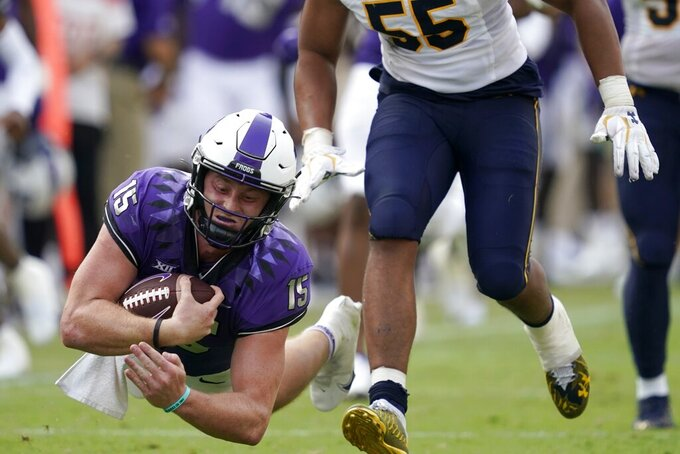 TCU quarterback Max Duggan (15) dives forward for more yardage after carrying the ball for a long gain as California linebacker Mo Iosefa (55) gives chase in the second half of an NCAA college football game in Fort Worth, Texas, Saturday, Sept. 11, 2021. (AP Photo/Tony Gutierrez)
