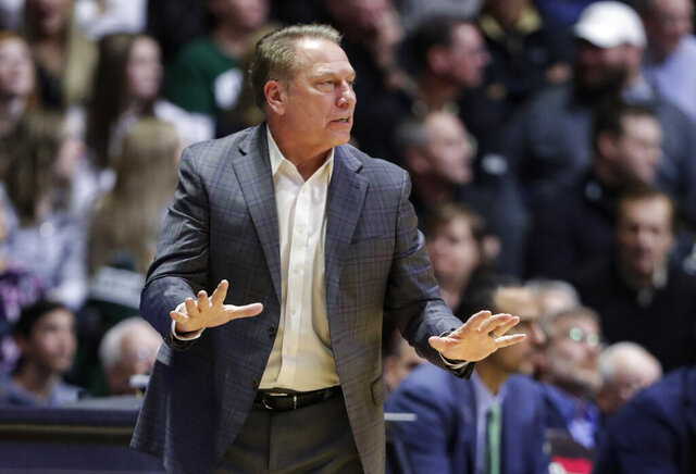 FILE - In this Jan. 12, 2020, file photo, Michigan State coach Tom Izzo gestures during the second half of the team's NCAA college basketball game against Purdue in West Lafayette, Ind. Michigan State basketball coach Tom Izzo has tested positive for COVID-19. The school's athletic department made the announcement Monday, Nov. 9, 2020. (AP Photo/Michael Conroy, File)