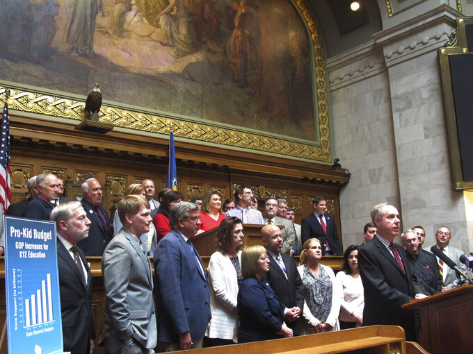 FILE - In this May 22, 2019, file photo, Wisconsin Assembly Speaker Robin Vos, standing at podium, surrounded by fellow Republican lawmakers, speaks at the Capitol in Madison, Wis. Wisconsin lawmakers are poised to take their first votes on police reform measures since George Floyd died last year. The state Senate is set to vote Tuesday, May 11, 2021, on five bipartisan bills. More divisive proposals, like banning the use of chokeholds, remain in the works.(AP Photo/Scott Bauer File)