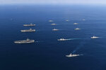 "FILE - In this Nov. 12, 2017, file photo provided by South Korea Defense Ministry, three U.S. aircraft carriers USS Nimitz, left top, USS Ronald Reagan, left center, and USS Theodore Roosevelt, left bottom, participate with other U.S. and South Korean navy ships during a joint naval exercises between the United States and South Korea in waters off South Korea's eastern coast. U.S. President Donald Trump promised to end ""war games"" with South Korea, calling them provocative, after meeting North Korean leader Kim Jong Un on June 12, 2018. His announcement appeared to catch both South Korea and the Pentagon by surprise. (South Korea Defense Ministry via AP, File)"