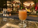In this Wednesday, Dec. 4, 2019 photo, the wassail cocktail is displayed at the Manetta's Bar in Flemings Mayfair Hotel in London.  While mulled wine, warm spiced cider and hot toddies have long been British staples during winter many cocktail bars in London offer their own seasonal winter warmers.  (AP Photo/Louise Dixon)