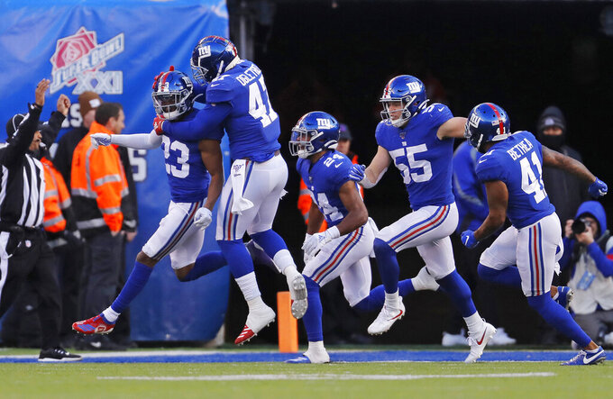 New York Giants defensive back Sam Beal (23) celebrates with teammates after tackling Miami Dolphins running back Patrick Laird (42) in the end zone for a safety during the third quarter of an NFL football game, Sunday, Dec. 15, 2019, in East Rutherford, N.J. (AP Photo/Adam Hunger)