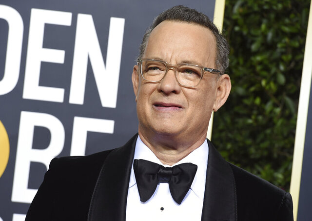FILE - In this Jan. 5, 2020 file photo, Tom Hanks arrives at the 77th annual Golden Globe Awards at the Beverly Hilton Hotel in Beverly Hills, Calif. For the first time in its lengthy history, 'Saturday Night Live' held an all-quarantine version, which aired Saturday, April 11 with stars delivering taped material primarily from their homes. Coronavirus pioneer Hanks was the guest host, with Chris Martin the musical guest and cameos from Larry David portraying Bernie Sanders and Alec Baldwin as President Donald Trump.  (Photo by Jordan Strauss/Invision/AP, File)