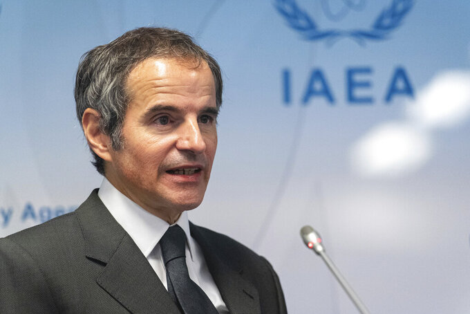 Director General of International Atomic Energy Agency, IAEA, Rafael Mariano Grossi from Argentina, addresses the media during a news conference behind plexiglass shields regarding the agency's monitoring of Irans's nuclear energy program at the International Center in Vienna, Austria, Monday, May 24, 2021. (AP Photo/Florian Schroetter)
