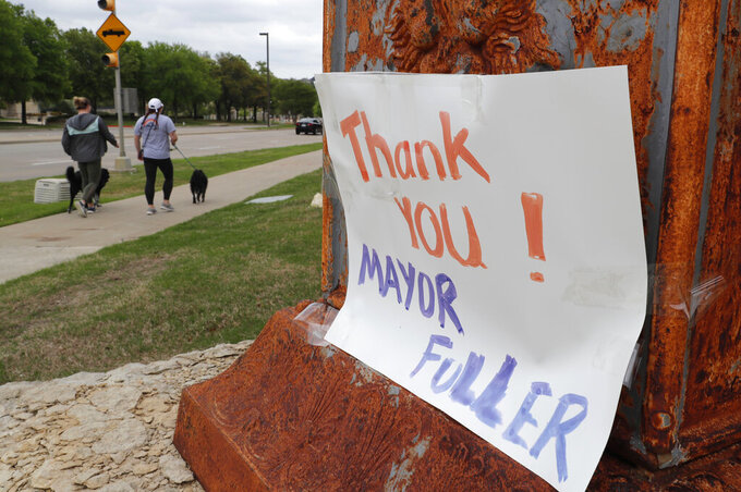 CORRECTS TO REMOVE INCORRECT POPULATION FIGURE - A sign of appreciation for McKinney Mayor George Fuller is posted near his office in McKinney, Texas, Thursday, April 2, 2020. Even though he conflicted with county officials, the suburban Dallas mayor defended his order that residents shelter at home to combat the spread of the coronavirus. Then he learned that his 19-year-old daughter had tested positive for COVID-19. Fuller said even as he worked to keep the city's residents safe from the virus, it seemed impossible that someone in his own family could be infected. (AP Photo/LM Otero)