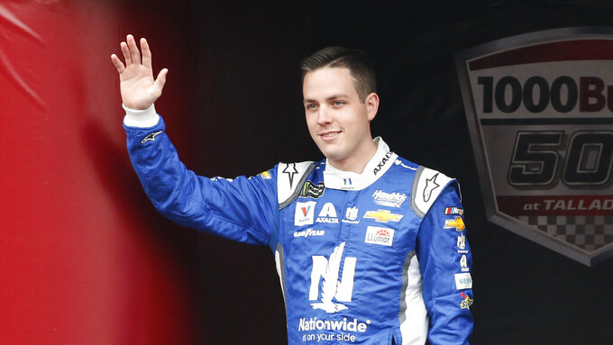 Monster Energy NASCAR Cup Series driver Alex Bowman (88) waves at driver introductions during a NASCAR Cup Series auto race at Talladega Superspeedway, Sunday, Oct. 14, 2019, in Talladega, Ala. (AP Photo/Butch Dill)