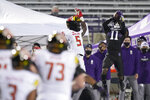 Northwestern defensive back A.J. Hampton (11) intercepts the ball against Maryland wide receiver Rakim Jarrett (5) during the first half of an NCAA college football game in Evanston, Ill., Saturday, Oct. 24, 2020. (AP Photo/Nam Y. Huh)