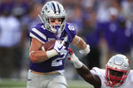 Kansas State running back Harry Trotter (2) breaks away from Nicholls State linebacker Giovanni LaFrance, right, for a touchdown during the first half of an NCAA college football game in Manhattan, Kan., Saturday, Aug. 31, 2019. (AP Photo/Orlin Wagner)