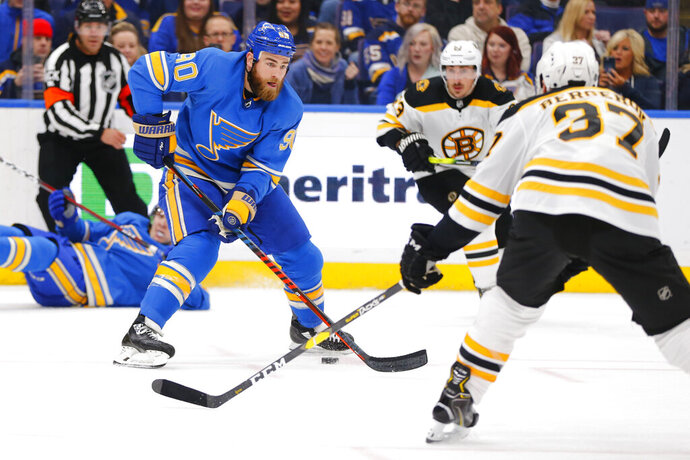 St. Louis Blues' Ryan O'Reilly (90) looks to pass the puck against the Boston Bruins during the second period of an NHL hockey game Saturday, Feb. 23, 2019, in St. Louis. (AP Photo/Dilip Vishwanat)