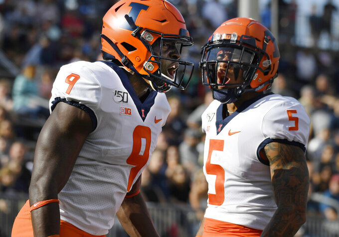 Illinois wide receiver Josh Imatorbhebhe (9) celebrates his touchdown with teammate Illinois wide receiver Trevon Sidney during the first half of an NCAA college football game, Saturday, Sept. 7, 2019, in East Hartford, Conn. (AP Photo/Jessica Hill)