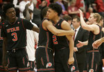 Utah guard Sedrick Barefield (2) hugs guard Charles Jones Jr., second from left, as they celebrate with teammates after defeating Stanford in an NCAA college basketball game in Stanford, Calif., Thursday, Jan. 24, 2019. (AP Photo/Jeff Chiu)