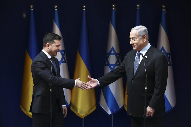 Israeli Prime Minister Benjamin Netanyahu, right, and Ukrainian President Volodymyr Zelenskiy, shake hands during their meeting in Jerusalem, Friday, Jan. 24, 2020. (AP Photo/Oded Balilty,pool)