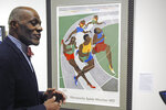 File-In this Jan. 11, 2018 file photo, Alan Page, NFL Hall of Famer and retired Minnesota Supreme Court justice, talks about a poster from the 1972 Olympics in Munich that was done by an African-American artist, which is among the artifacts of slavery and segregation collected by Page and his wife, Diane Sims Page.  Page has counted art collection among his many life pursuits, and the former Vikings star has two of his prized pieces up for sale through a New York auction house, each valued at more than $200,000.  (AP Photo/Steve Karnowski, File)