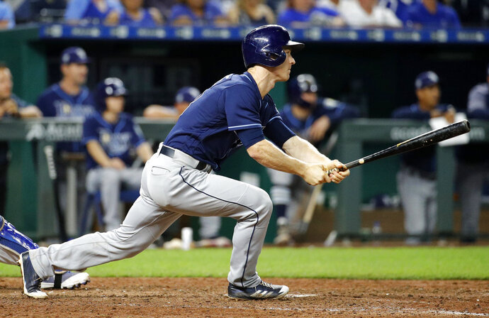 Tampa Bay Rays' Joey Wendle watches his RBI single during the ninth inning of a baseball game against the Kansas City Royals on Tuesday, May 15, 2018, in Kansas City, Mo. (AP Photo/Charlie Riedel)