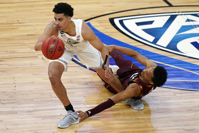 Oregon's Will Richardson (0) drives around Arizona State's Alonzo Verge Jr. (11) during the second half of an NCAA college basketball game in the quarterfinal round of the Pac-12 tournament Thursday, March 11, 2021, in Las Vegas. (AP Photo/John Locher)