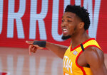 Utah Jazz's Donovan Mitchell celebrates a 3-point basket against the Denver Nuggets during the fourth quarter of Game 4 of an NBA basketball first-round playoff series, Sunday, Aug. 23, 2020, in Lake Buena Vista, Fla. (Kevin C. Cox/Pool Photo via AP)