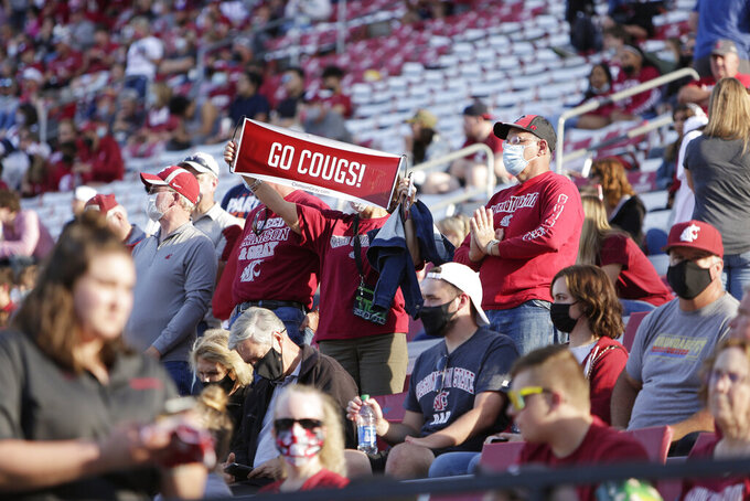 Washington State fans watch the team enter the field during halftime of an NCAA college football game against Portland State, Saturday, Sept. 11, 2021, in Pullman, Wash. (AP Photo/Young Kwak)