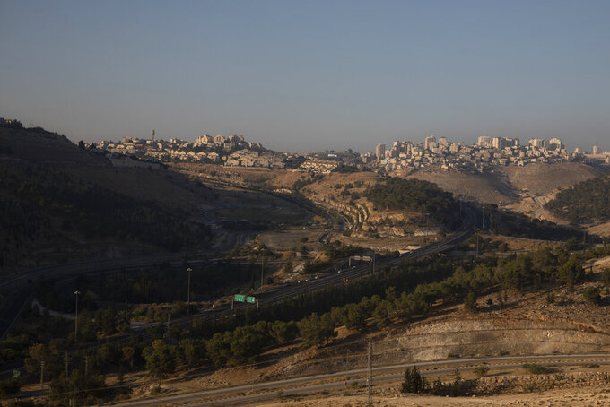 """This Monday, June 29, 2020 photo shows the Israeli settlement of Maale Adumim, in the West Bank. The U.N.'s human rights chief Michelle Bachelet said that Israel's plan to begin annexing parts of the occupied West Bank would have """"disastrous"""" consequences for the region, issuing her dire warning as senior U.S. and Israeli officials were meeting in Jerusalem trying to finalize the move. (AP Photo/Sebastian Scheiner)"""
