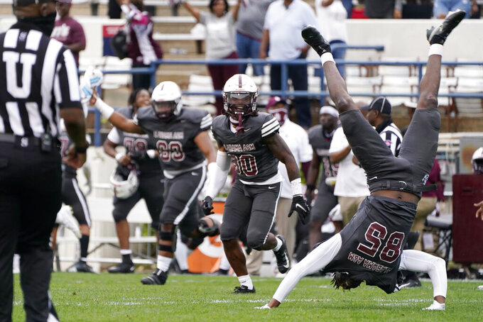 Alabama A&M wide receiver Abdul-Fatai Ibrahim (85) performs a celebratory handspring as the team celebrates a win over Arkansas-Pine Bluff in the Southwestern Athletic Conference championship NCAA college football game Saturday, May 1, 2021, in Jackson, Miss. Alabama A&M won 40-33. (AP Photo/Rogelio V. Solis)