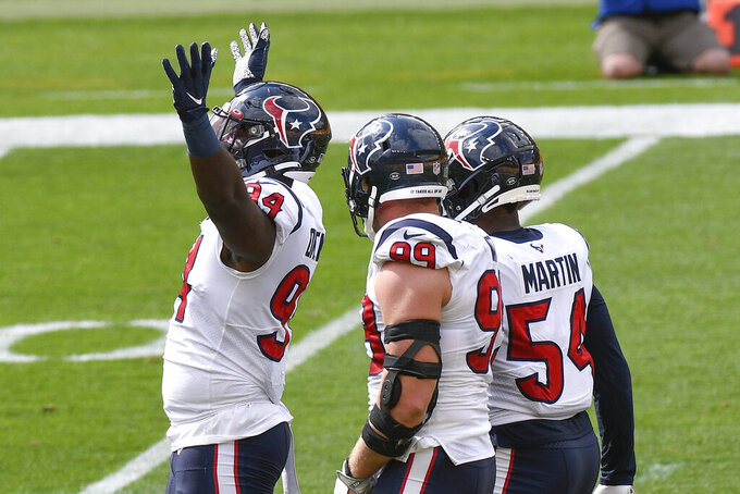 Houston Texans' Charles Omenihu (94) celebrates with teammates after they sacked Pittsburgh Steelers quarterback Ben Roethlisberger during the first half of an NFL football game, Sunday, Sept. 27, 2020, in Pittsburgh. (AP Photo/Don Wright)