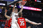 Oregon State's Kylor Kelley (24) dunks against Utah during the first half of an NCAA college basketball game in the first round of the Pac-12 men's tournament Wednesday, March 11, 2020, in Las Vegas. (AP Photo/John Locher)