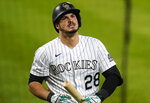 Colorado Rockies' Nolan Arenado reacts to striking out against the Oakland Athletics during the fourth inning of a baseball game Tuesday, Sept. 15, 2020, in Denver. (AP Photo/Jack Dempsey)