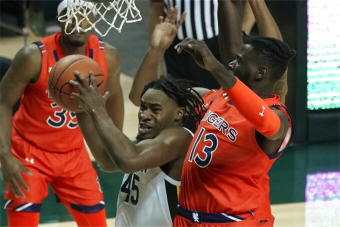 Baylor's Davion Mitchell (45) drives past Auburn's Babatunde Akingbola (13) during the second half of an NCAA college basketball game in Waco, Texas, Saturday, Jan. 30, 2021. (AP Photo/Chuck Burton)