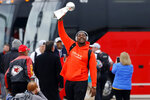Kansas City Chiefs defensive tackle Chris Jones holds up the Vince Lombardi Trophy as he and his teammates return home a day after winning the NFL Super Bowl 54 football game Monday, Feb. 3, 2020, in Kansas City, Mo. The Chiefs defeated the San Francisco 49ers to win their first championship in 50 years. (AP Photo/Colin E. Braley)