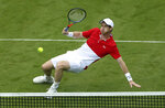 Britain's Andy Murray in action in his Men's Doubles tennis match with partner Brazil's Marcelo Melo against Juan Sebastian Cabal and Robert Farah of Colombia, during day three of the Nature Valley International at Devonshire Park, Eastbourne, England, Tuesday, June 25, 2019. (Steven Paston/PA via AP)