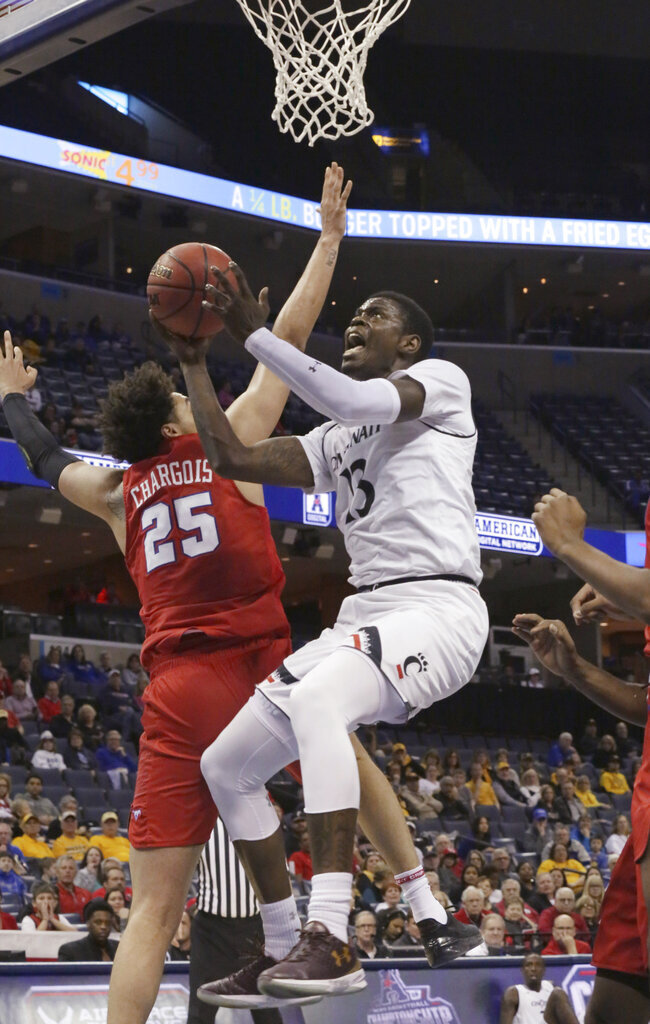 Cincinnati's Tre Scott goes in for a layup past SMU defender Ethan Chargois during the second half of an NCAA college basketball game at the American Athletic Conference men's tournament Friday, March 15, 2019, in Memphis, Tenn. (AP Photo/Troy Glasgow)