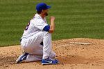 New York Mets pitcher Jacob deGrom reacts after giving up an RBI single to Miami Marlins' Lewin Diaz during the sixth inning of a baseball game on Monday, Aug. 31, 2020, in New York. (AP Photo/Adam Hunger)