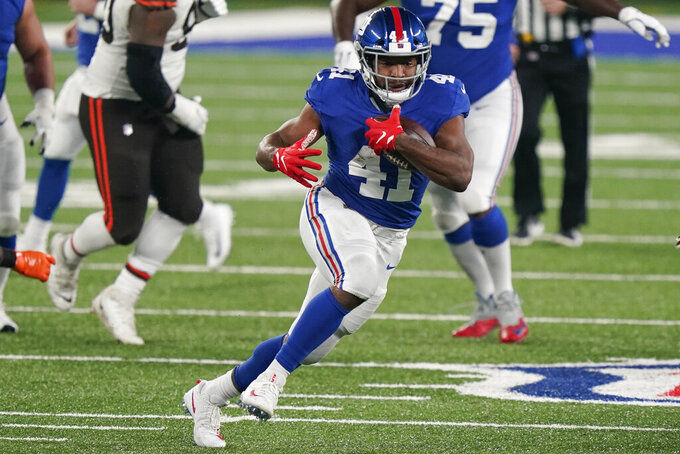 FILE - New York Giants' Alfred Morris (41) rushes during the first half of an NFL football game against the Cleveland Browns in East Rutherford, N.J., in this Sunday, Dec. 20, 2020, file photo. The Giants on Monday, Aug. 2, 2021, announced the re-signing of Alfred Morris. (AP Photo/Corey Sipkin, File)
